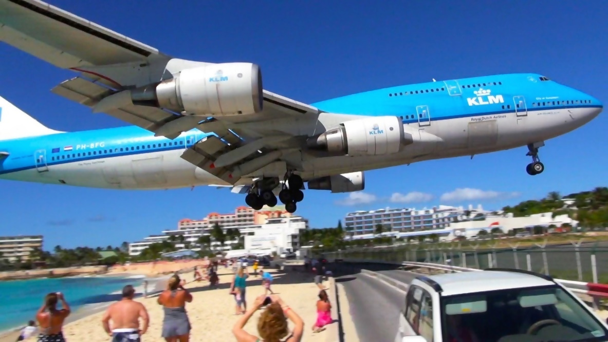 An airplane coming in for a landing at St. Maarten airport.