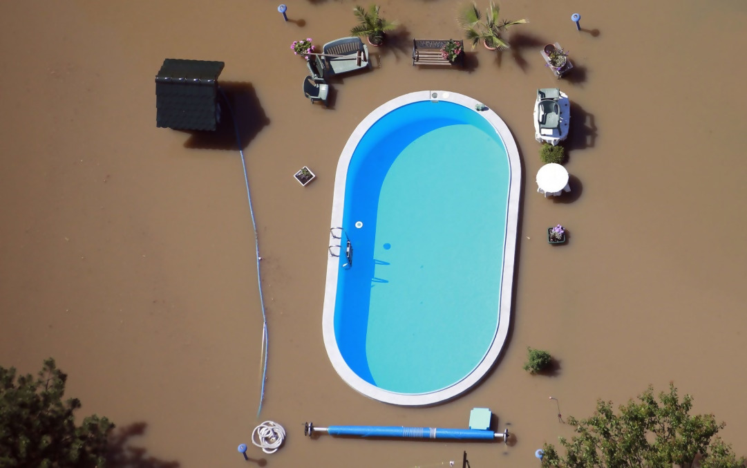 During this flood, the flood water almost spilled over into someone's pool,but didn't.