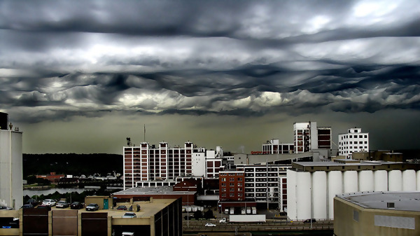 Terrifying storm clouds forming over a city.