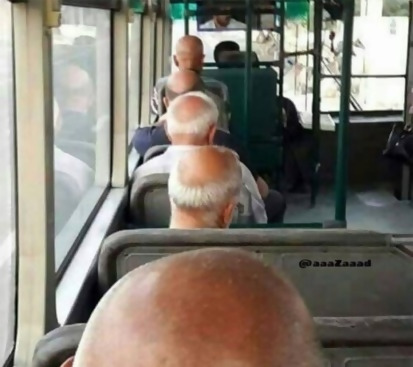 a line of bald people sitting on a bus